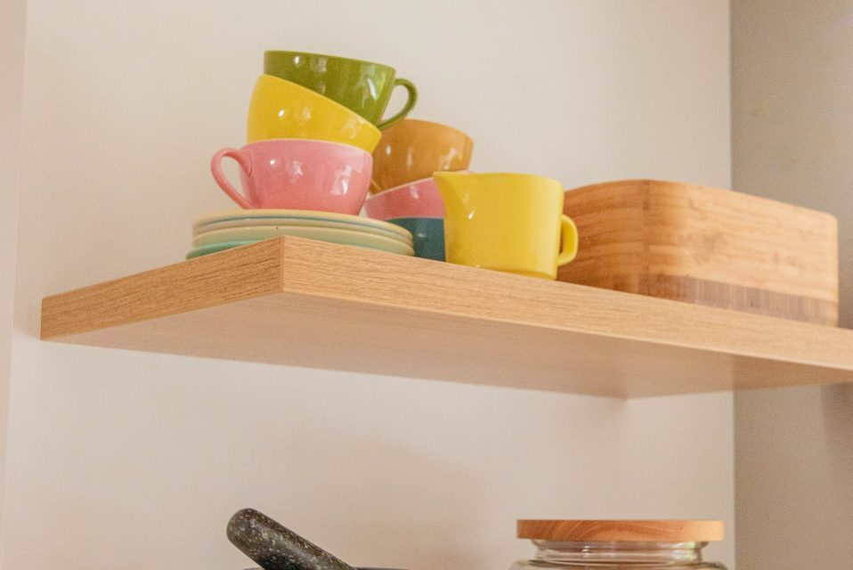 dishes on the shelf as a symbol of how to pack your pantry for a move from New Jersey