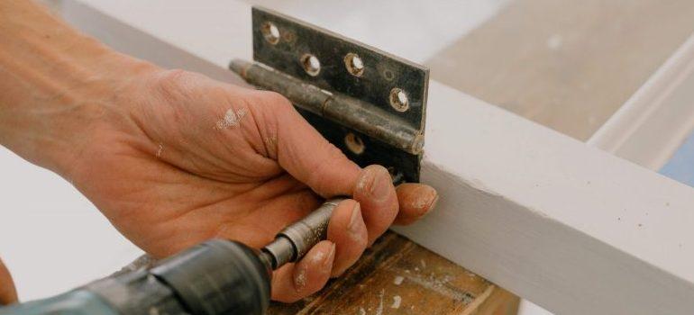 person assembling wooden furniture