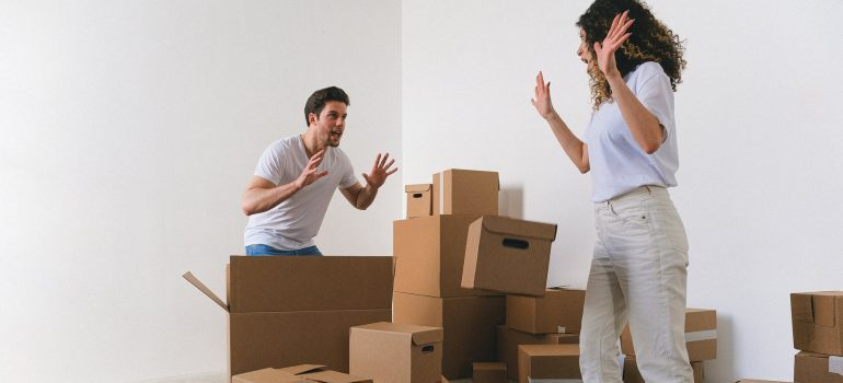 a couple packing your household