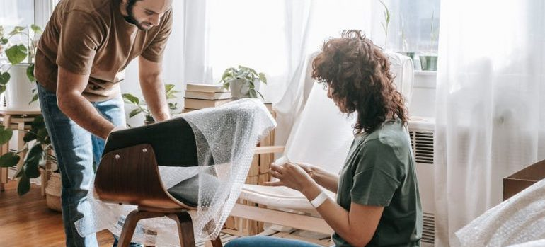 couple preparing to hire expert furniture movers
