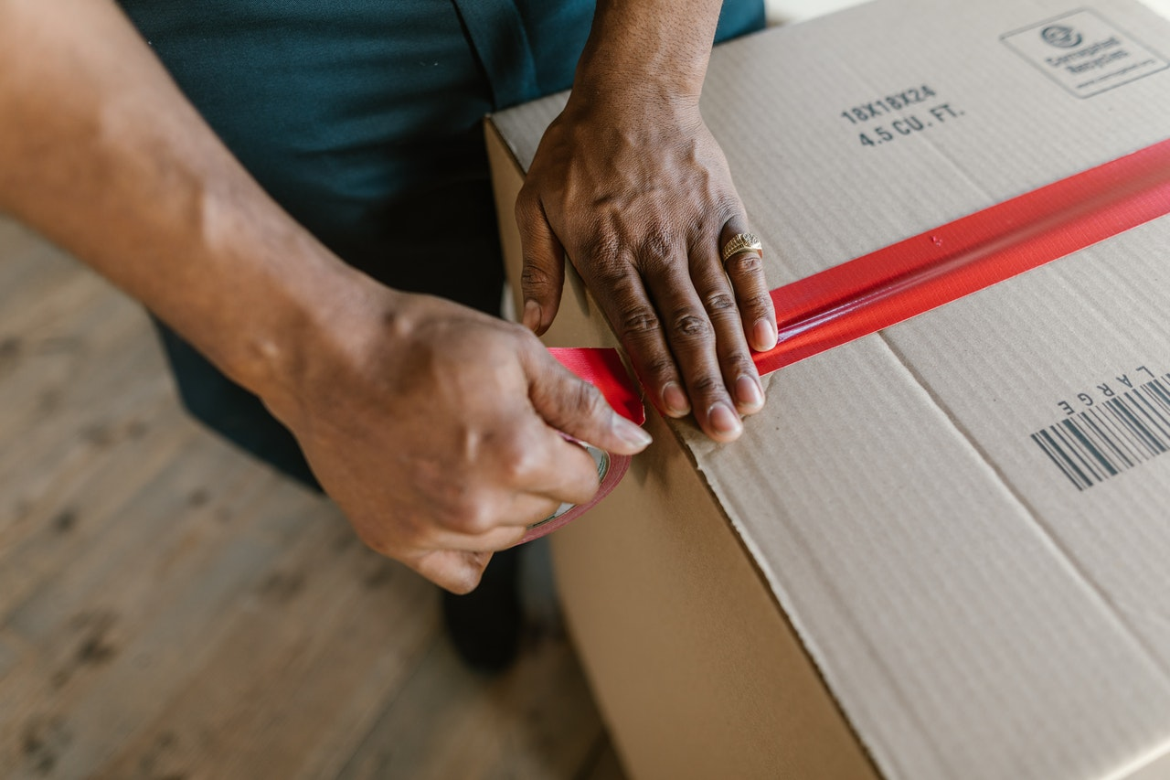 a member of professional packers NJ taping a box