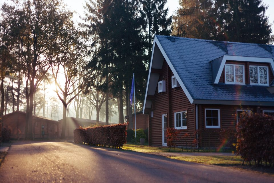 a house in the woods as a symbol of how to organize a long-distance move from New Jersey