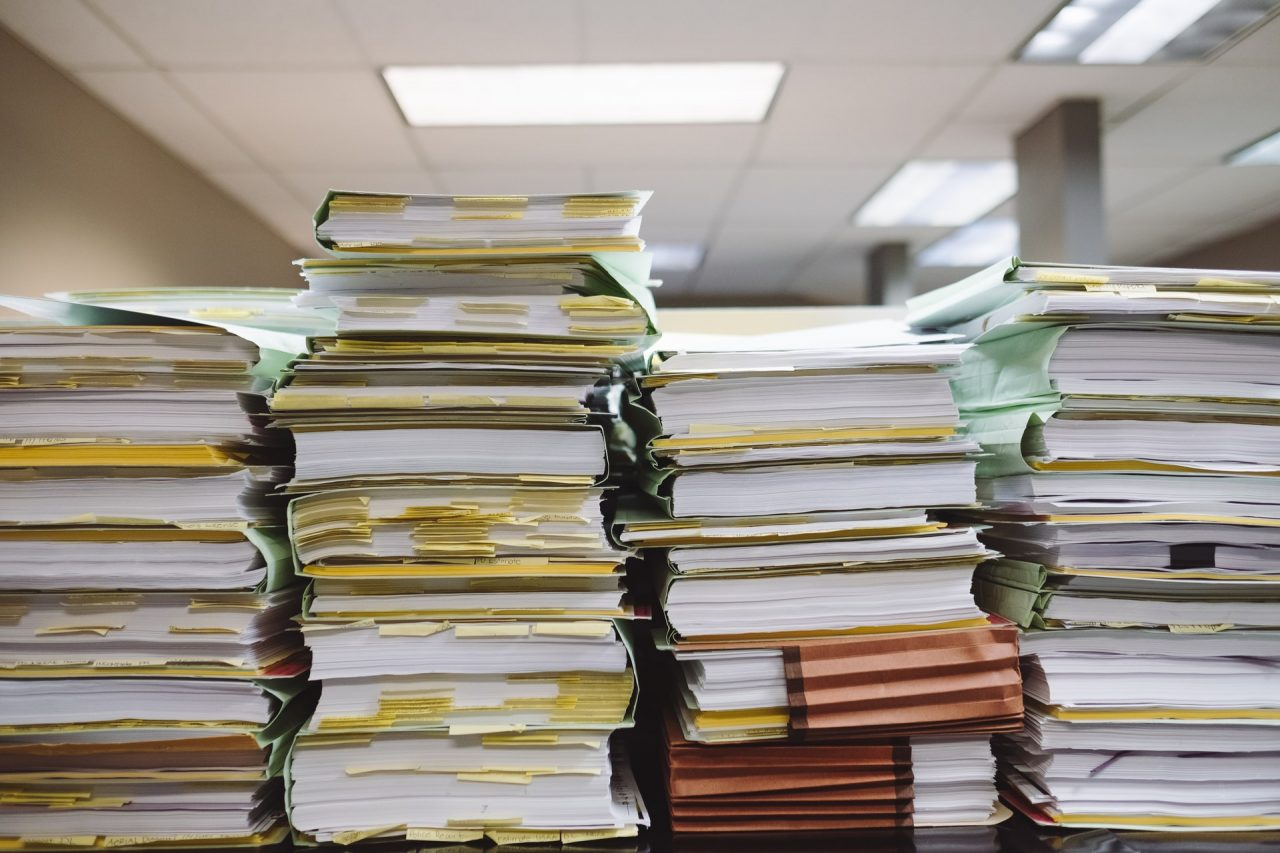 paperwork and books stacked