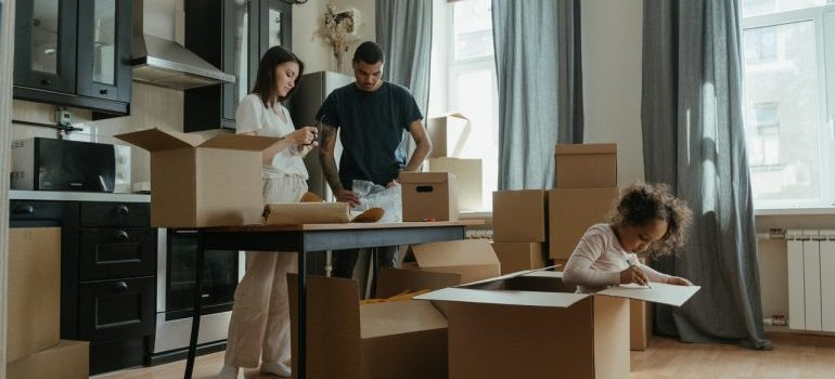 a family packing and waiting for moving companies Secaucus NJ to come